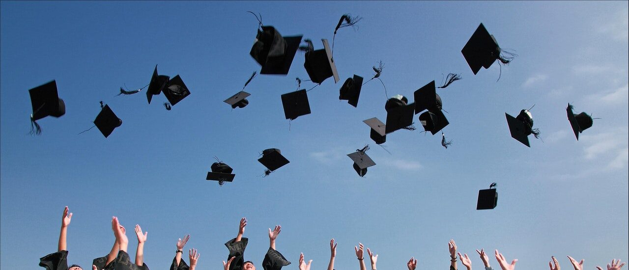 graduation ceremnony mortartboard throwing