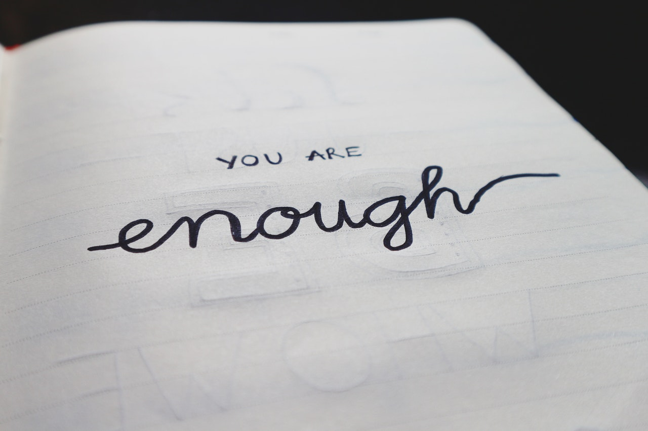 Motivational text reading you are enough